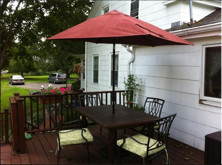 The Purple Painted Lady Patio Umbrella Primer Red after