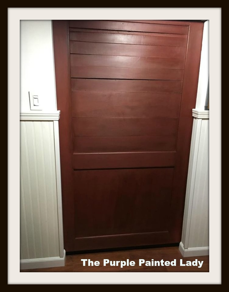 Anne painted her door with a couple coats of Primer Red and then Anne applied a coat of Annie Sloan\u0027s Clear Wax. and then applied a coat of Dark Wax. & Primer Red Chalk Paint® on a Basement Door | The Purple Painted Lady